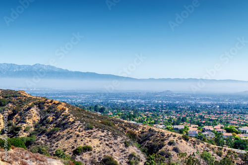 Haze and sunshine over suburbs of Southern California on hot summer morning Poster