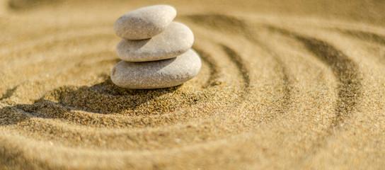 Fototapeta na wymiar zen meditation stone in sand, concept for purity harmony and spirituality, spa wellness and yoga background
