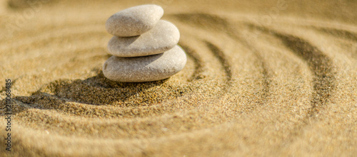 Acrylic Prints Stones in Sand zen meditation stone in sand, concept for purity harmony and spirituality, spa wellness and yoga background