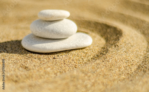 Foto op Plexiglas Stenen in het Zand zen meditation stone in sand, concept for purity harmony and spirituality, spa wellness and yoga background