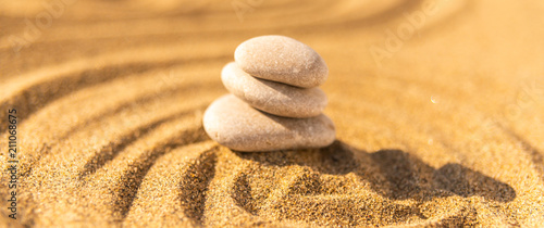 Tuinposter Stenen in het Zand zen meditation stone in sand, concept for purity harmony and spirituality, spa wellness and yoga background