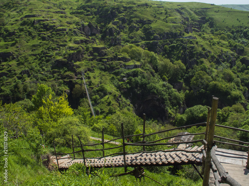 Tuinposter Wijngaard Wood Stairs over Canyon of Khndzoresk in the Syunik Province, Armenia 2