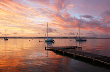 Beautiful Marine After Sunset Background.Amazing Summer Evening Landscape With Group Of Drifting Yachts On A Lake Mendota During Spectacular Sunset. Bright Sky Reflects In The Lake Water. Madison, WI.