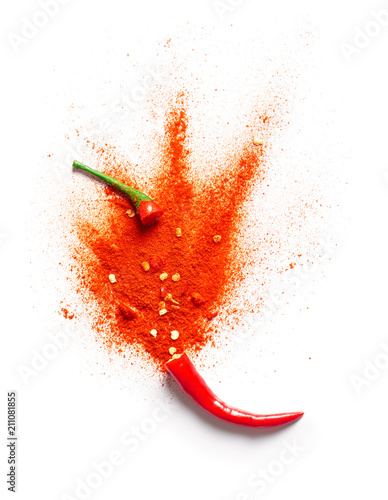 Cadres-photo bureau Hot chili Peppers Chili powder bursting out of a red chili pepper
