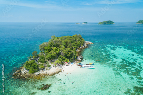 Fototapeta Aerial view of Unidentified tourists enjoy and relax on the white sand beach at Koh Rok Roy or Koh Rokroy (Rok Roy Island), Lipe Island, Tarutao National Marine Park, Satun Province, Thailand. obraz