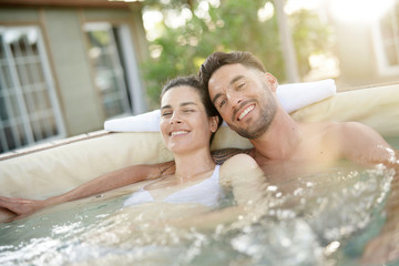 Couple enjoying relaxing time in jacuzzi