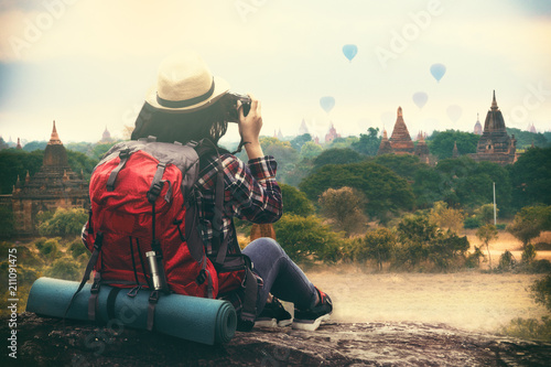 Backpacking woman traveller and photographing in Bagan Mandalay Myanmar Canvas Print