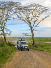 Safari Car Stands On Dirt Road...