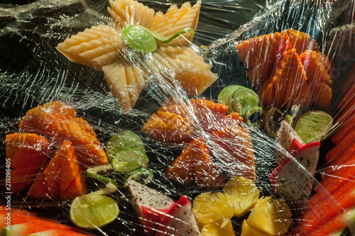 Poster Buffet, Bar Assorted fruits, wrapped in plastic wrap for buffet line in wedding party.