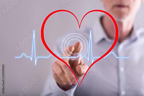 Photo Man touching a heart beats graph