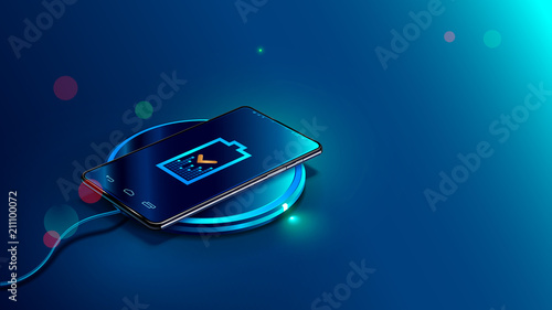 Foto Black smart phone on wireless charging device on blue background
