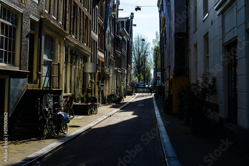 Photo Stands New York Old narrow street in Amsterdam