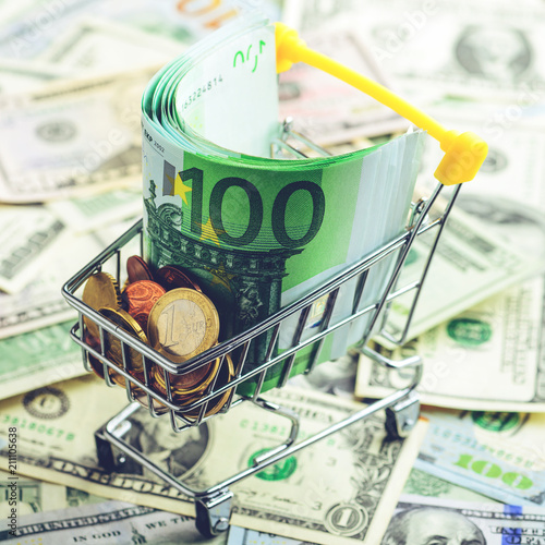 Poster Euro banknotes and coins in the shopping cart, toned image. Conc