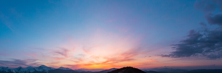 Sunset sky above mountains