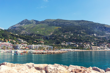 View of Menton city harbour from french Riviera in a beautiful summer day, France. Sea with mountains that make a beautiful contrast.