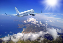 Passenger Airplane In The Clouds. Aerial View Of Airplane And Blue Lagoon In Oludeniz