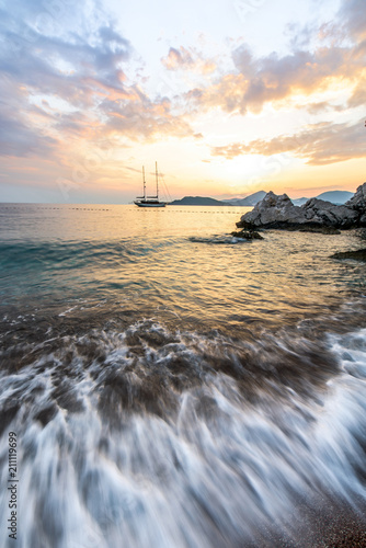 sunset on the Adriatic sea, long exposure. ship at sunset Poster