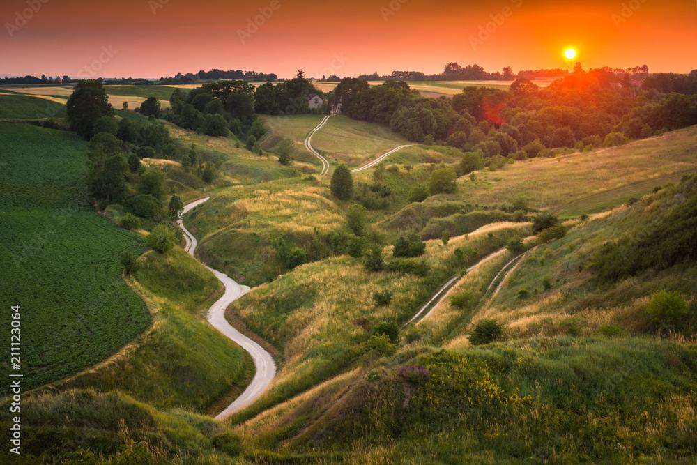 Sunset over a winding road on Ponidzie, Swietokrzyskie, Poland