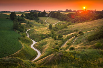 Sunset over a winding road on Ponidzie, Swietokrzyskie, Poland