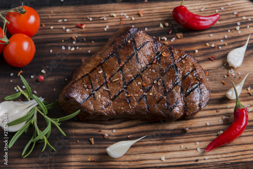Spoed Foto op Canvas Steakhouse beef grilled steak on board