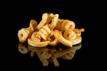 Curly Fries With Reflection Isolated On Black Background