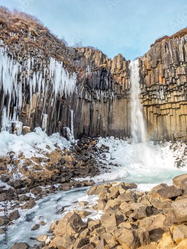 Tuinposter Watervallen Svartifoss waterfall in winter season, Iceland