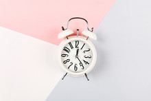 White Antique Alarm Clock On A...