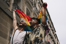 Smiling Couple With Pride Flag