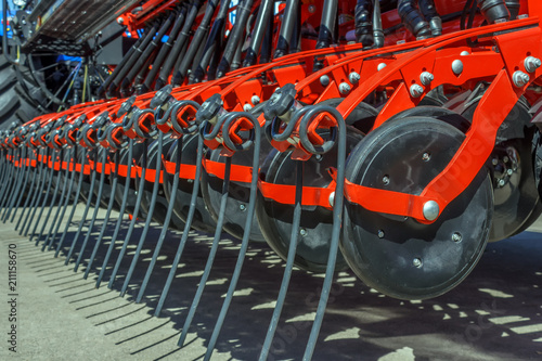 Fototapeta Mechanisms for the tractor are used for cultivating the land and planting seeds