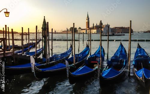 Türaufkleber Gondeln Gondolas anchored at pier of San Marco square at sunrise on Grand Canal towards San Giorgio Maggiore, Venice, Italy.
