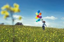 Little Boy Walking On Meadow W...