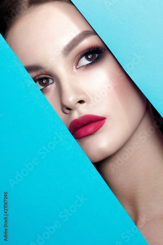 Fototapety, obrazy: Young beautiful woman with clean perfect skin through gap in cardboard