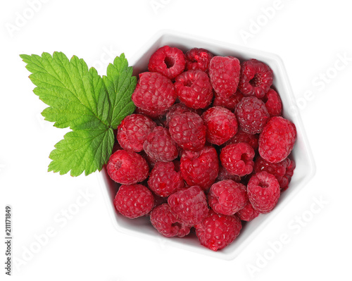 Bowl with ripe raspberries on white background, top view