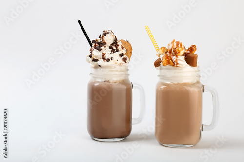 Tuinposter Milkshake Mason jars with delicious milk shakes on white background