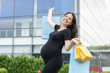 Happy Pregnant Woman With Shop...