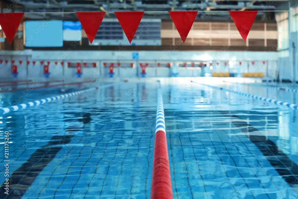 Fototapety, obrazy: Modern swimming pool with blue water, indoors