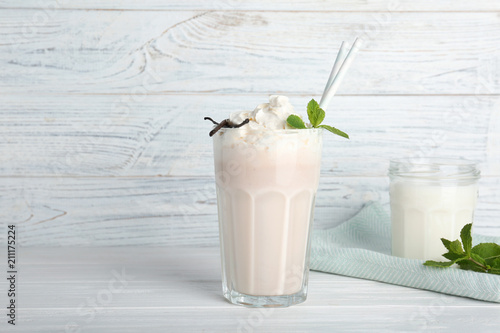Photo Stands Milkshake Glassware with delicious milk shakes on table
