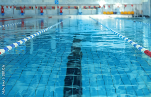 Fotografiet Modern swimming pool with blue water, indoors