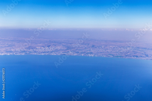 Tuinposter Cyprus Airplane view over Cyprus, relief of the island and beautiful turquoise Mediterranean with boats and ships in the waters. Airplane wings in the early morning.