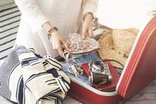 Woman Preparing Summer Luggage