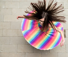 Girl In Rainbow Dress Spinning