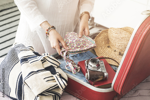 Woman preparing summer luggage