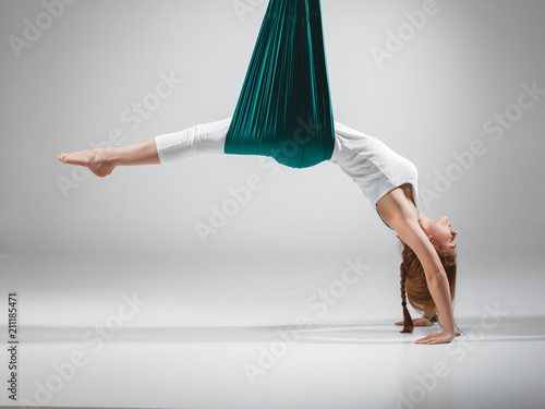 Different inversion aerial yoga with a hammock Canvas Print