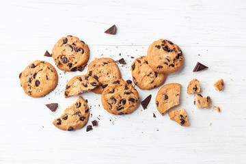 American cookies with chocolate chips on white wooden background. Top view.