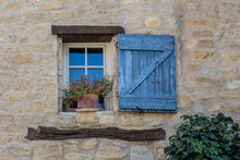 Window And Blue Shutter In Provence, France