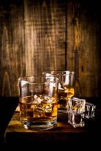 Two Whiskey Shot Glasses On Da...