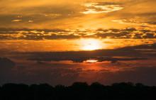 Sunrise With Sun Peeping Throu...