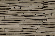 Close Up Detailed Image Of A Modern Dry Stone Wall Made Of Irregular Grey Slabs