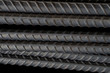 steel background, steel construction, construction irons for building, stack of ribbed steel