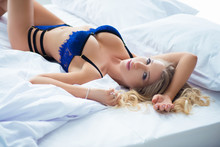 Beautiful Sexy Young Woman In Lingerie Lying On The Bed.